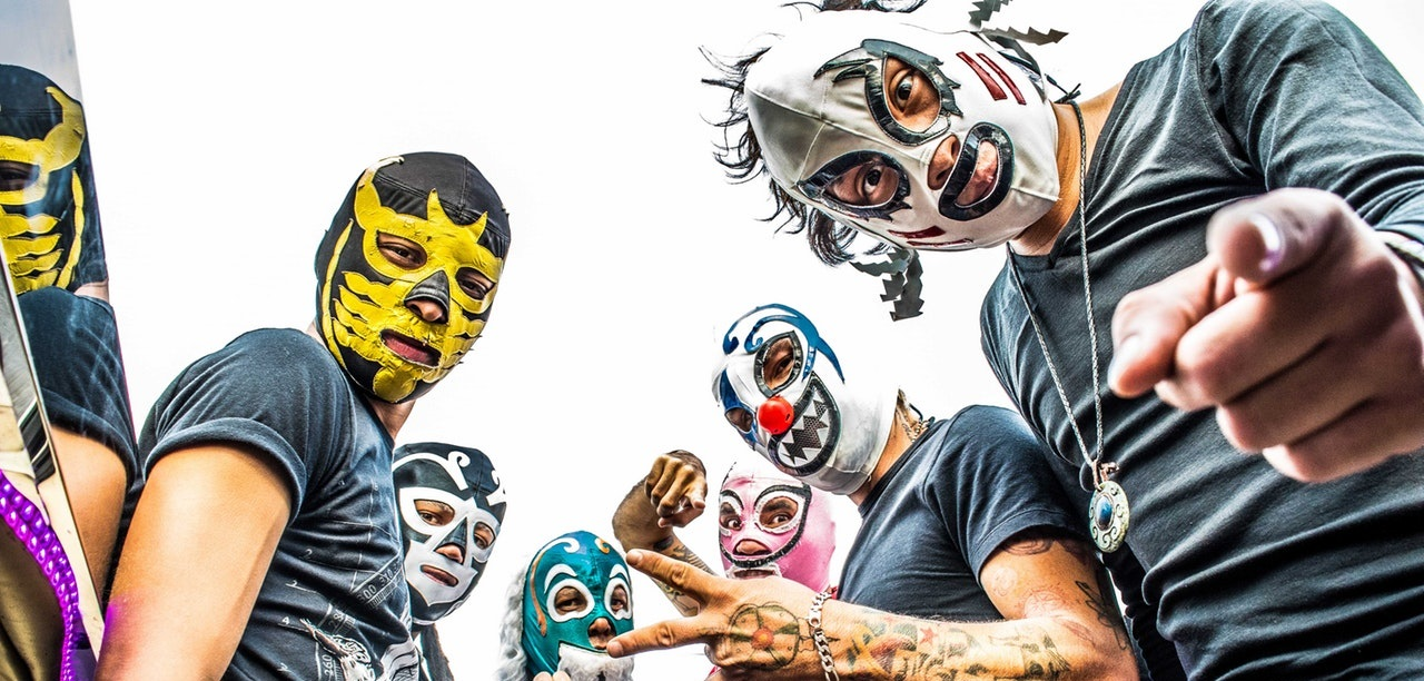 Group of fans wearing Mexican wrestling masks